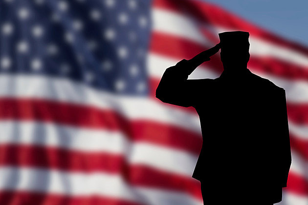 Soldier saluting the USA flag for memorial day